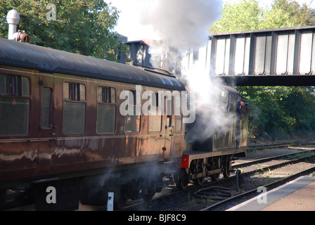 A tank engine pulls away from Sheringham Station on the North Norfolk railway - Stock Image