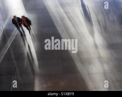 Couple walking through Mall, New York City, USA - Stock Image