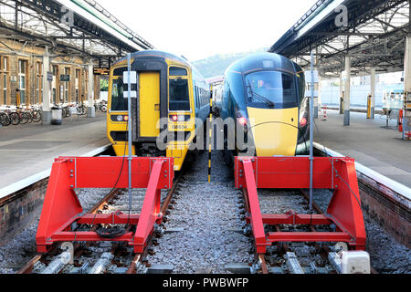 Old diesel train and new Hitachi GWR 800 waiting side by side on the rail tracks by buffers at Swansea Railway Station in South Wales UK  KATHY DEWITT - Stock Image