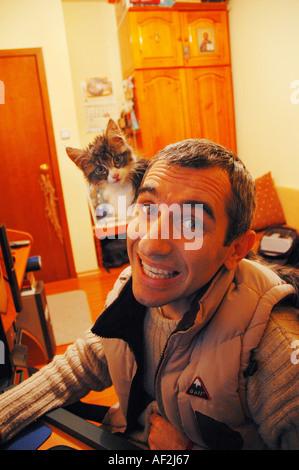 Nick Chaldakov and the cat - Stock Image