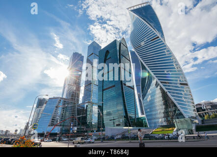 Moscow, Russia - June 24, 2017: Business center of Moscow-city streets under skyscrapers against the blue sky with the sun - Stock Image