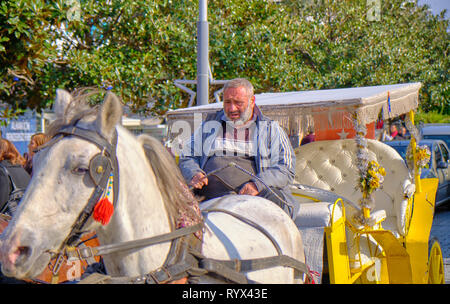horse drawn carriage driver on old town street of Antalya, Turkey - - Stock Image