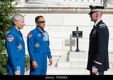 NASA astronauts Mark Vande Hei, left, and Joe Acaba, center, meet with the Honor Guard at the Tomb of the Unknowns, Friday, June 15, 2018 at the Arlington National Cemetery in Arlington, Va. - Stock Image