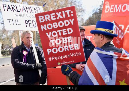 London, UK. 25th Mar 2019. Steve Bray, Activist, SODEM confronts a UKIP supporter, Remain Protest, Houses of Parliament, Westminster, London. UK Credit: michael melia/Alamy Live News - Stock Image