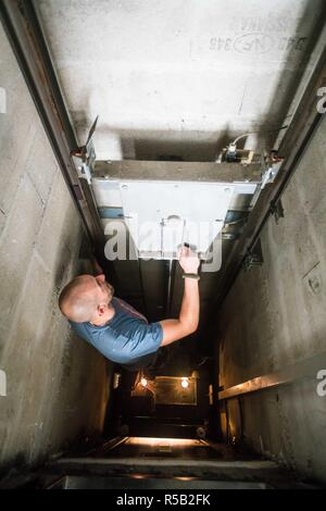 Repairing a lift. - Stock Image
