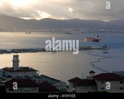 Dusk over the Bay of Gibraltar, Custom House, boom, shipyard shipyards sunset sunsets dusk evening nightfall  Gibraltar Harbour - Stock Image