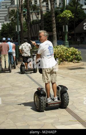Tourist on Segway on pavement, Waikiki, Honolulu, Hawaii, USA - Stock Image