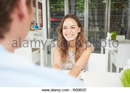 Young couple at cafe - Stock Image