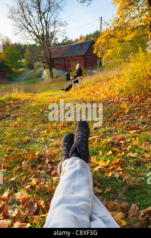 Two people enjoying an autumn afternoon - Stock Image