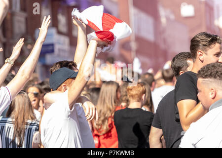 London, UK. 7th June 2018.Over a thousand (police estimate) celebrating England fans blocked Brentwood High Street, letting off smoke bombs and chanting for about half an hour.  The crowd was mostly good natured and happy at the England victory Credit Ian Davidson/Alamy Live News - Stock Image