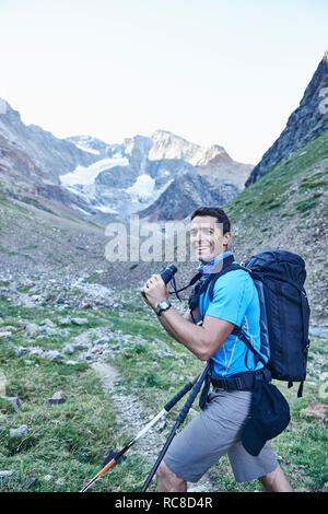 Hiker using binoculars, Mont Cervin, Matterhorn, Valais, Switzerland - Stock Image