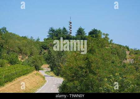 The landscape near Smartno in Primorska, Slovenia,  showing the Gonjace Observation Tower on Mejnik Hill in the distance - Stock Image