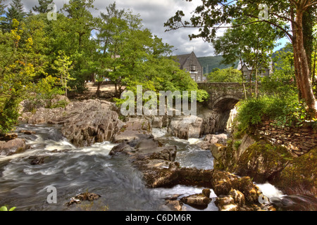 Hdr image of Betws y Coed bridge and waterfall in Wales. - Stock Image