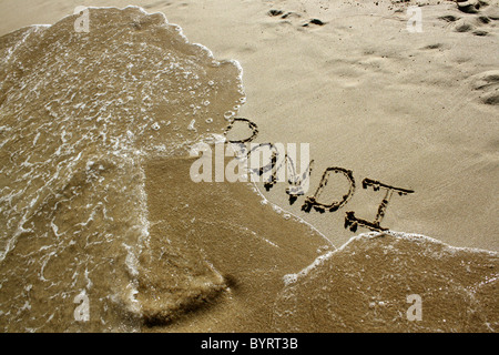 'Bondi' written out in wet sand. Please see my collection for more similar photos. - Stock Image