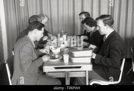 1950s, school teachers sitting together having lunch, England, UK. - Stock Image