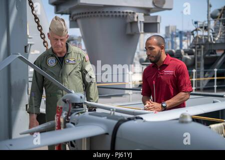 180902-N-GX781-0029 CARTAGENA, Colombia (Sept. 2, 2018) Rear Adm. Sean Buck, commander, U.S. Naval Forces Southern Command, receives a presentation of Aerosonde MK 4.7 G during a tour of the Whidbey Island-Class Dock Landing Ship USS Gunston Hall (LSD 44). The Gunston Hall is in Cartagena, Colombia for UNITAS 2018. UNITAS is an annual international exercise in the U.S. Southern Command area of responsibility where partner nations participate in multinational exchanges to enhance interoperability, increase regional stability, and build and maintain regional relationships with countries througho - Stock Image