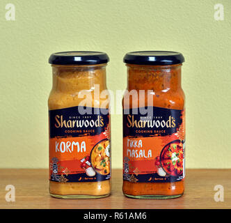 Two jars of Sharwood's Cooking Sauce. Korma and Tikka Masala. England, United Kingdom, Europe. - Stock Image