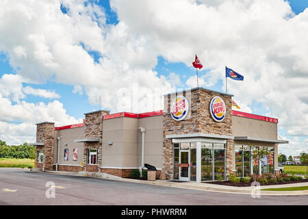 Front exterior entrance of Burger King fast food restaurant showing the drive thru or through lane in Montgomery Alabama, USA. - Stock Image