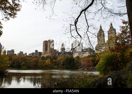 Autumn in the Central Park, New York, United States, view to the lake and buildings - Stock Image