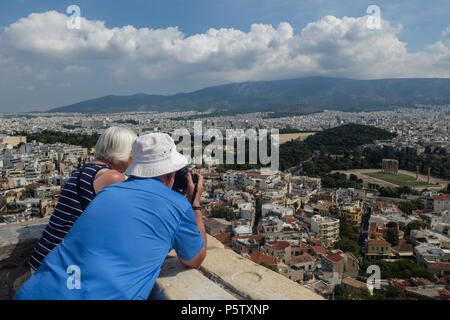 Couple taking in the Sights and views of Athens from the Acropolis, Athens, Greece. - Stock Image