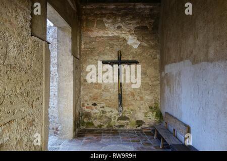 Wooden Cross on Stone Wall of Santo Domingo Monastery Catholic Church in Old Town Antigua Guatemala - Stock Image