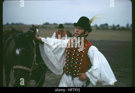 Horseman in flamboyant traditional outfit of the Puszta, Hungary. - Stock Image