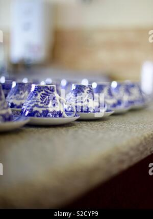 Willow pattern cups and saucers - Stock Image