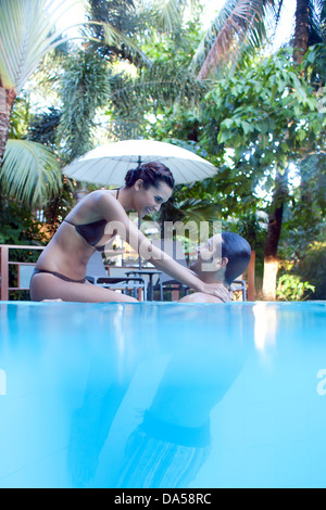 A young couple swimming. - Stock Image