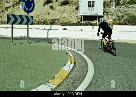 Cyclists cycling in Murcia Spain during a February winter break. - Stock Image