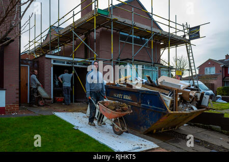 Builders carrying out a major refurbishment of a residential house in a North Yorkshire Village - Stock Image