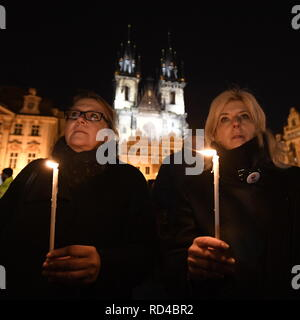 Their Hands. 16th Jan, 2019. The people commemorating Jan Palach, the student who immolated himself in protest against the Soviet-led occupation of Czechoslovakia 50 years ago, set out on a march through the Prague centre in silence and with candles in their hands January 16, 2019. The rally was called by the group Million of Moments. Palach set himself on fire on January 16, 1969 in order to wake up people from the lethargy with which they accepted the occupation of Czechoslovakia. He died of fatal burns three days later, aged 20. Credit: Michal Krumphanzl/CTK Photo/Alamy Live News - Stock Image