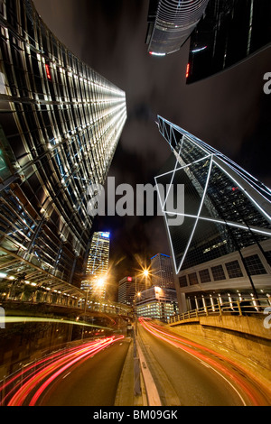 Car trails and skyscrapers at night in Hong Kong - Stock Image