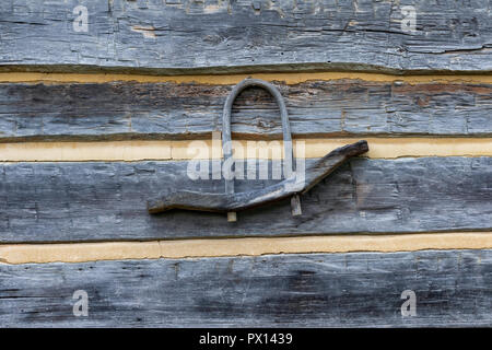 Limestone, TN, USA, Single wood yoke hanging on cabin exterior wall. - Stock Image