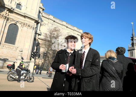 City of London school boys pupils students in uniform at lunchtime near St Pauls Cathedral in London England UK  KATHY DEWITT - Stock Image