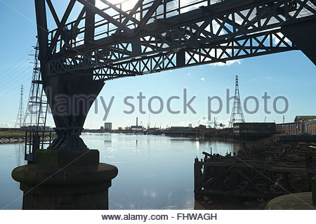 The River Usk in Newport, viewed from under the Transporter Bridge, and the city's docks in distance. Newport, - Stock Image
