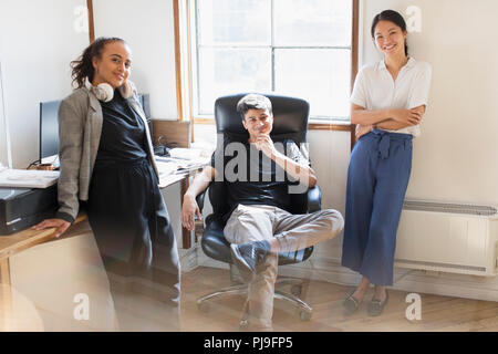 Portrait confident creative business people in office - Stock Image