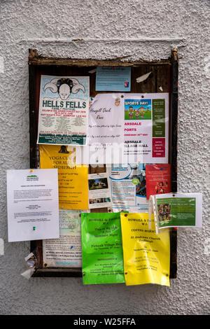UK, Cumbria, Sedbergh, Main Street, Community Notice Board, advertising local events - Stock Image