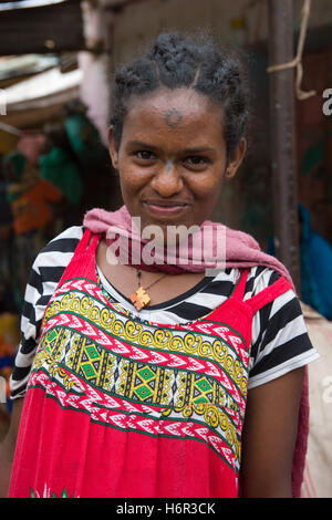 Young girl with a traditional cross tattoo on her nose in the market at Dire Dawa, Ethiopia - Stock Image