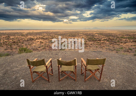 Chairs on a cliff overlooking Africa Savannah. Landscape. - Stock Image