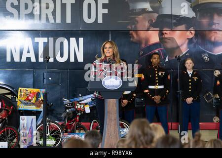 U.S. First Lady Melania Trump delivers remarks during a Toys for Tots Christmas Event at Joint Base Anacostia-Bolling December 11, 2018 in Washington, DC. Toys for Tots is a Marine Corps Program that collects new unwrapped toys and distribute those toys to less fortunate children at Christmas. - Stock Image
