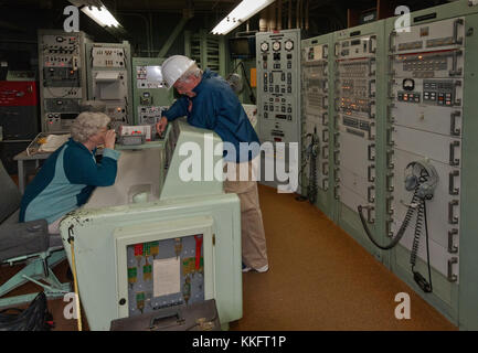 Guide and visitor at underground Launch Control Center at Titan Missile Museum near Green Valley, Arizona, USA - Stock Image