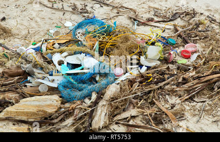 Trash collected on coastal beach, Gulf Of Mexico. - Stock Image