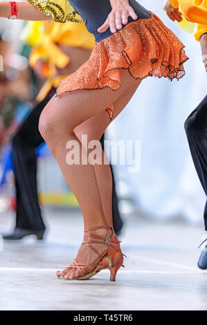 Spanish dancing troupe performing on an outdoor stage. Expo Latino Festival, Calgary Alberta Canada - Stock Image