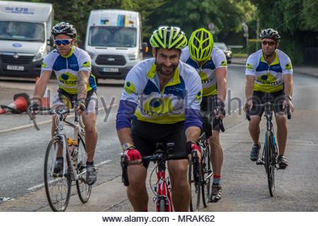 Hook, Hampshire, UK. 26th May 2018. Cancer patient and father of three Gareth Lancaster (40) and a team of cyclist from Cornwall are riding 240 miles of the Trafalgar Way from Launceston to Admiralty Arch, London to raise funds for Sarcoma UK. Over £13k has already been pledged. Despite major surgery last year in Birmingham Orthopaedic Hospital to remove a tumour and much of the front of his pelvis, Gareth's cancer has returned and he will require further surgery after the ride. Photo: Gareth leads the team away on the final leg of the second day. Credit: Images by Russell/Alamy Live News - Stock Image