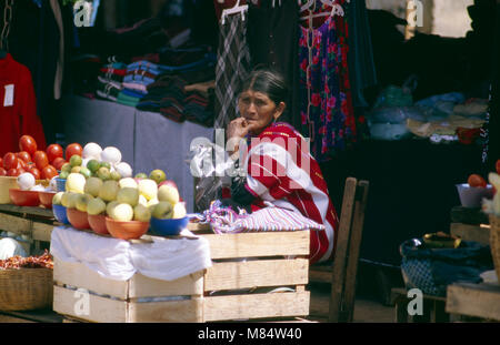 An indigenous Tzeltal woman trades surplus fruit and vegetables at the weekly market in Oxchuc, Chiapas State, Mexico. - Stock Image