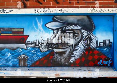 graffiti wall mural  of a sailor smoking a pipe. Fremantle, Western Australia. - Stock Image