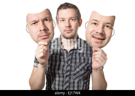 Picture of a man choosing the right face for the day - Stock Image