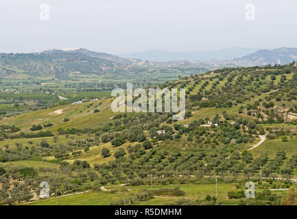 View towards the west and the town of Pisticci  from the castle wall  in the hilltop town of Bernalda in Basilicata, Southern Italy - Stock Image