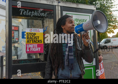 London, UK. October 9th 2018. The rally begins outside the New Atlas Cafe Restaurant where a young black man was attacked by police who used obviously unnecessary force when arresting him on suspicion of having been involved in a knife attack. He was assaulted by six officers, and was viciously kicked while officers struggled to handcuff him, andwhen he was well under control and held on the ground he was sprayed in the face with CS gas. Credit: Peter Marshall/Alamy Live News - Stock Image