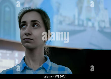 Young woman looking around in modern historical museum - Stock Image